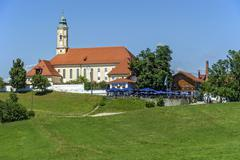 Annunciation church with beer garden and brewery of Reutberg abbey Sachsenkam Stock Photos