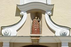 Statue of the Virgin Mary on the portal of the Church of the Annunciation Stock Photos