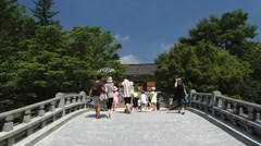 Tourists pass by the bridge to Bulguksa temple in Gueongju, Korea. Stock Footage