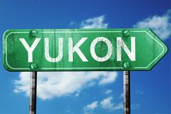 Stock Illustration of yukon road sign , worn and damaged look