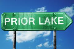 prior lake road sign , worn and damaged look - stock illustration