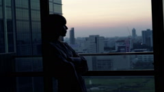 Silhouette young woman in bathrobe admire city view from terrace Stock Footage