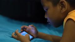 Little boy playing on smartphone 4k UHD (3840x2160) Stock Footage