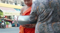 People give rice and foods to monks as gift religious ceremony Stock Footage