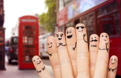 close up of hands and fingers with smiley faces - stock photo