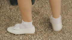 Little girl dancing in white shoes. Stock Footage