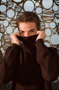 Young man portrait sweater pulled up - stock photo