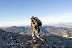 Man on a trek Stock Photos