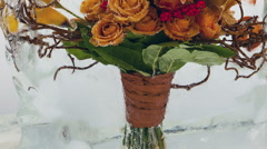 Frozen flowers. Creative abstract bright flowers and ice with air bubbles. Stock Footage
