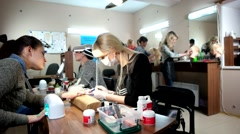 Beauty hair salon nail salon Dolly shot of women work. - stock footage