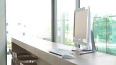 Modern office space light and glass architect building with computer on table Stock Footage
