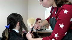 Hairdresser mows the tips of the hair to the customer in the barber shop. Stock Footage