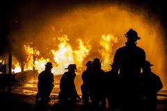 Firefighters assessing structural fire Stock Photos