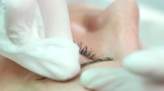 Master cloth wipes before applying eyebrow tattoo woman in the office. - stock footage