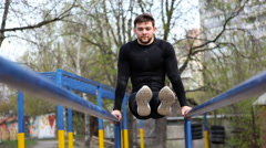 Athlete Doing Exercises on Uneven Bars - stock footage