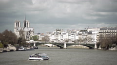 Tourism in Paris. Boat on the Seine with Notre dame in background Stock Footage