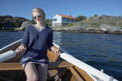 Young woman in rowing boat Kuvituskuvat