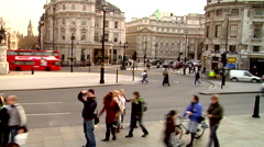 Trafalgar Square, black cabs and double decker buses, people or person in shot, Stock Footage