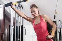 Sports background. Muscular fit woman exercising. Stock Photos
