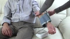 Man measuring his blood pressure. Stock Footage