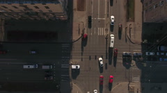 Camera rotating above crossroads in the city, cars driving Stock Footage