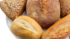 Breads and baked goods: Camera pans across large assortment in HD video - stock footage