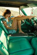 Woman in car one leg on dashboard Stock Photos