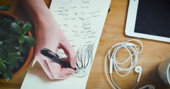 Young designer working on a creative project - stock footage