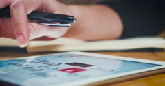 Young designer working on a creative project using the tablet - stock footage
