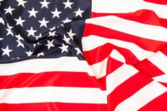 USA flag. Pure linen fabric flag carefully folded Stock Photos