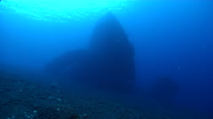 Ocean scenery hull lying on its starboard side, shot from deep, on black sand Stock Footage