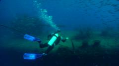 Male model scuba diver swimming on wreckage in Australia, HD, UP19663 Stock Footage