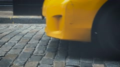 Yellow cab on stone pavement in SOHO, New York - stock footage