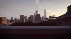 Magic hour dolly in shot of downtown Manhattan skyline - stock footage