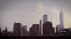 Magic hour dolly in shot of downtown Manhattan skyline Stock Footage