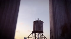 Dolly in on water tower in NYC during sunset Stock Footage