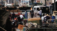 People unload frozen fish from the fishing boat at the sea port in Busan, Korea. - stock footage
