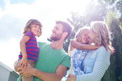 Parent carrying children Stock Photos