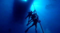 Group of scuba divers making a safety stop on water surface, HD, UP19828 Stock Footage