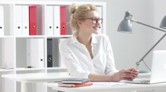 Businesswoman talking on the phone in the office Stock Footage