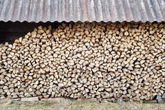 stack of chopped firewood - stock photo