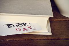 book and text book day in a piece of paper - stock photo