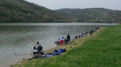 Feeder fishing competition on the lake, beautiful sunny day by Pakito. Stock Footage