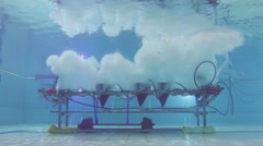 Under water bubble machine in swimming pool Stock Footage