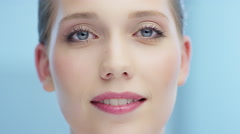 Attractive woman makes grimace and blinks in camera Stock Footage