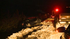 Auto accident, highway accident scene night black ice, #3 vehicle in ditch Stock Footage