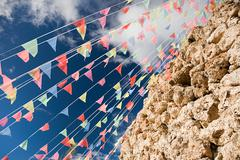 Bunting by rocks - stock photo
