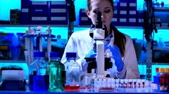Woman Looking Through Microscope Stock Footage