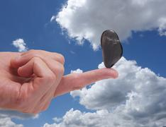 Finger balance and blue sky Stock Photos