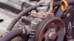 Serpentine belt on car engine rotating in slow motion Stock Footage